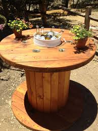 Wooden spool table. Sanded and stained the spool. Cut a hole in the middle