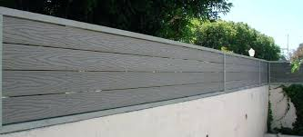 wood fence on top of concrete block wall composite a city fence topper extend the height wood fence on top of concrete block wall