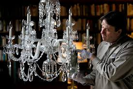 chandeliers bring elegance and shine to any room until they re due for a cleaning how professionals maintain the notoriously hard to reach lighting