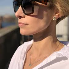 "Efva Attling Stockholm - ""Go For It"" sunglasses here with ""A Green Dream""  earring and necklace. 