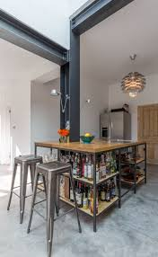 Modern style industrial kitchen | open shelving | exposed structure | steel  beams | kitchen island
