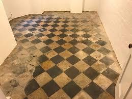 restoring old quarry tiles in a reading basement