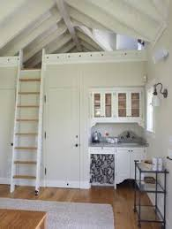 loft ladder and rail idea would want steps not a ladder but could do the tiny kitchen size and umed bathroom or bedroom under loft