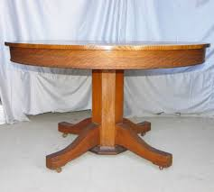 antique round oak dining table with 3 original leaves sold