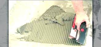 easiest way to remove tile from concrete floor removing old tile adhesive from concrete floor how
