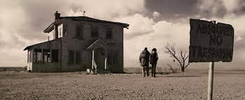 carnegie tells eli to throw out the book everyone is ready for the gunfight a covered parcel is hurled through the window