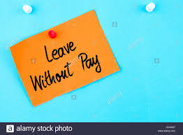 leave out pay written on orange paper note pinned on cork  leave out pay written on orange paper note pinned on cork board white thumbtack copy space available