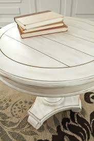 ashley t505 106 mirimyn round accent table