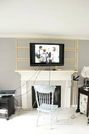 how hide cords fireplace putting your tv above over gas can you put wood burning