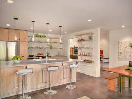 open shelving above the work space and on the wall to the side makes this kitchen easy to navigate