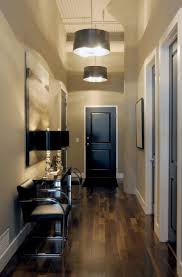 best foyer lighting. Interior, Modern Entryway House Design With Hanging Pendant Lamp Fixtures From Ceiling Plus Dark Hardwood Best Foyer Lighting