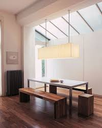 usona long linear light fixture over a rectangular dining room table