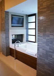 tv in bathroom. modern bathroom by slic design tv in houzz