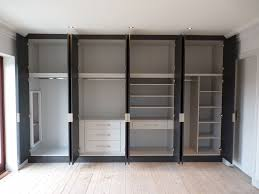 without door built in wardrobe in white and black color panel with triple drawers also shoes racks for minimalist walk in closet