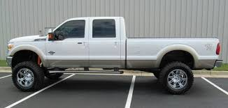 This 2012 Ford F-250 Super Duty Is Running A 8-inch Superlift With 38-inch  Tires On 20-inch Rims. F