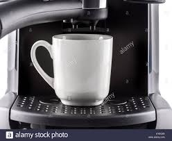 closeup of modern coffee machine with white mug stock photo