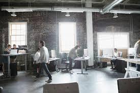 loft office. Creative Business People Working In Open Plan Loft Office S