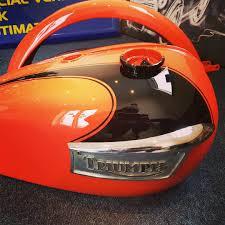 orange triumph motorbike custom paint job 8