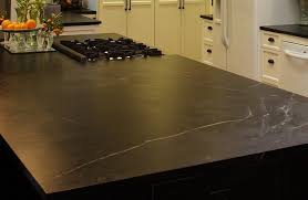 large kitchen island with soapstone countertop and stove