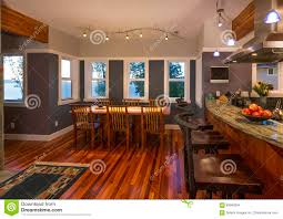 upscale dining room furniture. Dining Room And Kitchen Breakfast Bar With Wood Floors Granite Countertops In Contemporary Upscale Home Interior Furniture S