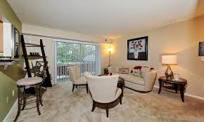 cedar gardens and towers apartments townhomes offers a spacious living room in windsor mill
