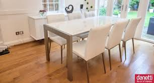 dining room modern white high gloss dining table design with open access to outdoor garden