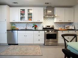 glass subway tiles kitchen glossy dark brown floorings folding wall tile lights frosted front upper cabinets stainless steel countertop white