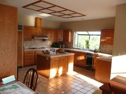 colors with dark cabinets sevenstonesinc kitchen beige wall paint and glass windows with brown wooden oak cabinet also