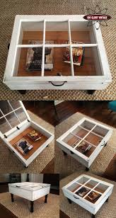 Reclaimed window coffee tables. Love the fact it opens for storage. What a  great