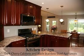 kitchen design dark cherry cabinets and black stainless steel appliances