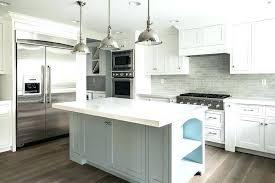 grey and white kitchen cabinets with gray brick tile backsplash subway whit