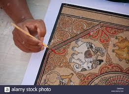 burmese sand painting cloth is textured with sand and hand painted stencils are taken from various temples in bagon myanmar