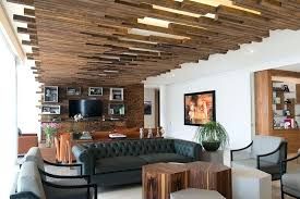 ceiling ideas for living rooms when were designing this apartment in city they decided to define ceiling ideas