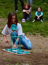 garden montessori school student ella stiles launches a water balloon from her homemade catapult