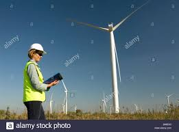 female engineer green collar jobs next to wind turbine wind farm female engineer green collar jobs next to wind turbine wind farm