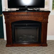 twin star electric fireplace faux in mahogany mantel with granite top