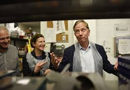 connecticut governor elect ned lamont right reacts after putting on a hairnet to