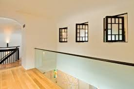 Inspiration for a mid-sized contemporary medium tone wood floor and yellow  floor hallway remodel