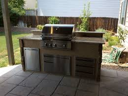outdoor kitchen located in parker colorado with mixed stone veneer and stucco