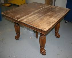 this large antique quartersawn red oak table came to us with a well worn veneered top and three leaves built with plywood that was 1 8 thinner than the