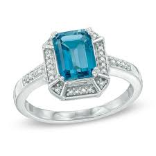 emerald cut london blue topaz and 1 10 ct t w diamond frame ring