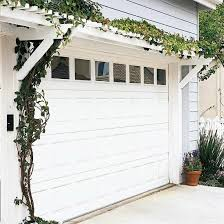 garage door pergola pact and simple this garage door pergola is an affordable weekend project and an easy way to dress up a garage