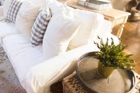 white slipcovered sofa with kids