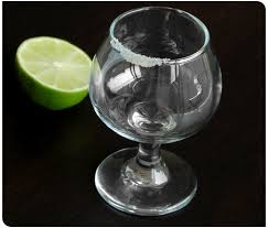 tequila glass with salt and lime