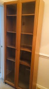 tall billy bookcase with glass doors