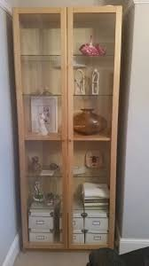 ikea billy bookcase with glass doors and lights