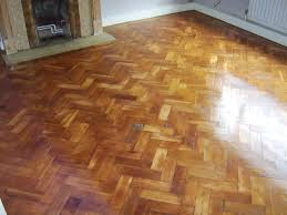 parquet floor after restoration sanding staining with walnut colour and 3 coats of clear satin
