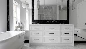 modern black and white bathroom features a white glass globe pendant ralph lauren hendricks large globe pendant hanging over a waterworks empire
