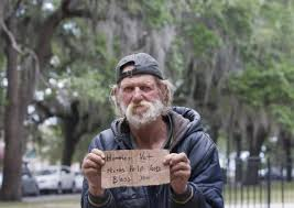 causes of homelessness essay sample net homeless man holding a sign