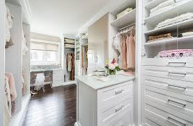 white dressing room walk in closet with plenty or storage